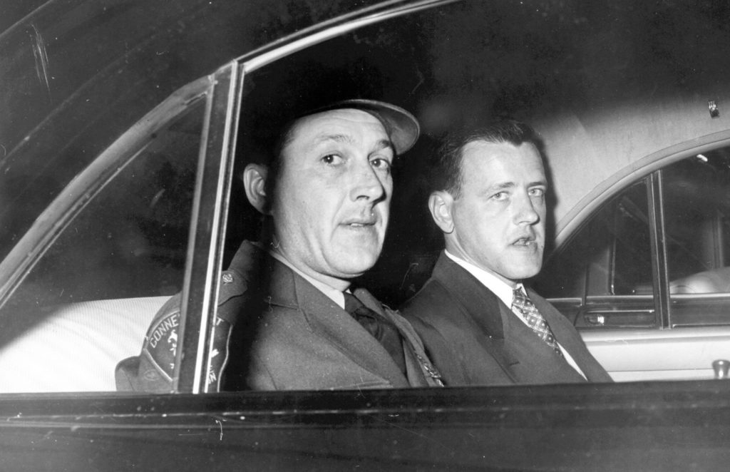 "Joseph ""Mad Dog"" Taborsky (right) on the way to the trial"